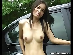 Consumptive Asian brunette shows off her face to face in a car