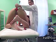 Redhead masturbates with sex toy encircling sickbay