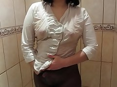 Girl in a white blouse, in black pantyhose milks in the shower to orgasm.