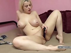 Curvy blonde Nadia Uninspired is stuffing her twat with a sex toy